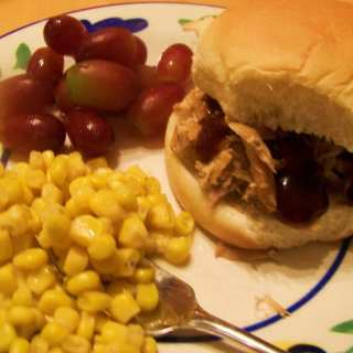 Crock Pot Pulled Pork Barbeque with Sweet Corn and fruit.