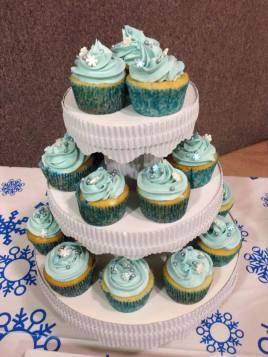 icey cupckes on stand