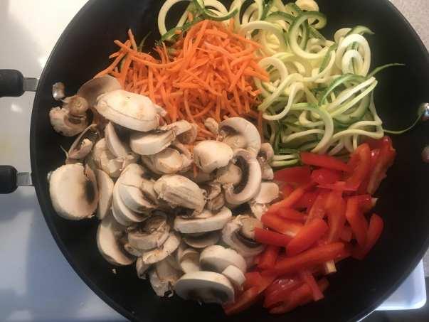 Cook vegetables in a stir fry pan.