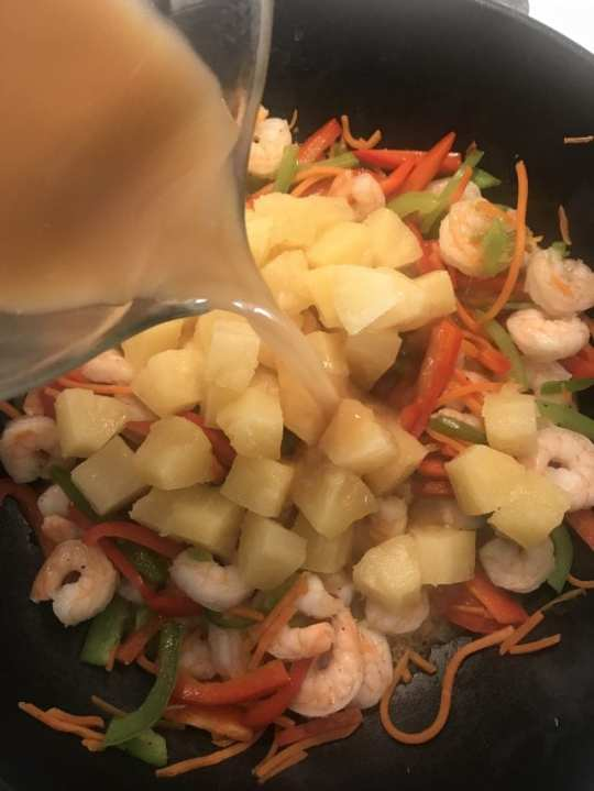 This sweet and sour shrimp stir fry is 4 Weight Watcher SmartPoints on the FreeStyle program. Cook the shrimp, pineapple, and bell peppers in a sweet and sour sauce served with brown rice on the side.