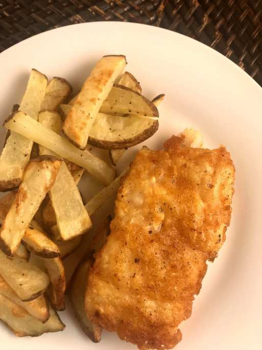 Healthy battered cod fish and chips perfect for anyone on the WW (Weight Watchers) program. Just 6 WW FreeStyle SmartPoints per battered fish fillet and one serving of fries!