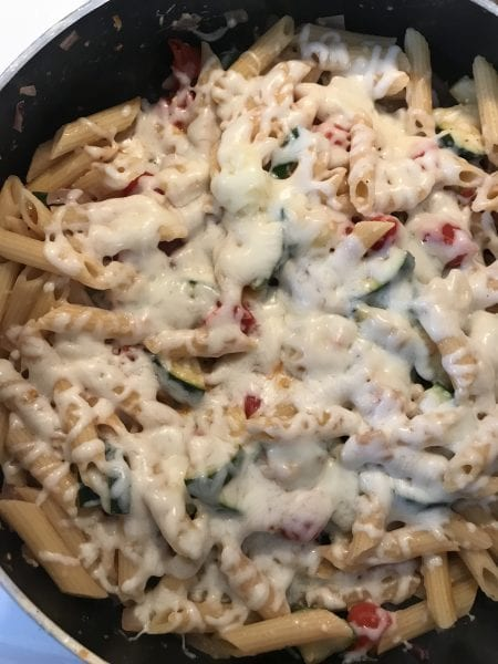 Melt mozzarella cheese on the pasta and veggies by covering skillet as it cooks.