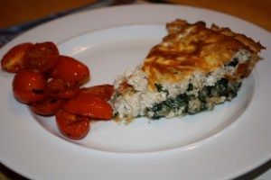 Chicken, oatmeal, mushroom and spinach quiche with tomatoes