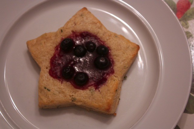 Scones with raspberry jelly and blueberries