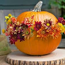 Using an ice pick, poke holes around the center of a pumpkin and place real or silk flowers at intervals.