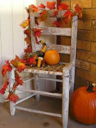 Decorate an old chair (the more roughed up the better) with a few gourds and small pumpkins.  Add a leaf stringer you can find at any craft store.