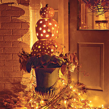 """This would take a bit more time...but it is the same concept as some of those """"stacked pumpkins"""" above. I like using battery operated candles rather than the real ones....for obvious reasons."""