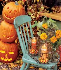 I love using old chairs in my Secret Garden....Decorate with a mum plant, candles, and let the kids cut out several pumpkins and insert a dowel to hold together.
