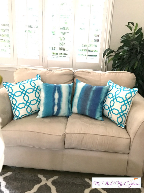 blue pillows on coastal living room sofa