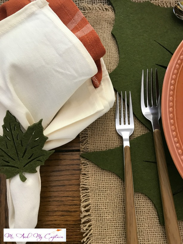 Layered napkins which is two napkins, one in side of the other and anchored by a felt leaf napkin ring.