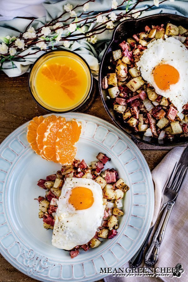Restaurant Style Corned Beef Hash Recipe | Mean Green Chef | A family tradition our Corned Beef Hash Recipe is made with roasted potatoes to add extra crispy deliciousness! Then sautéd to perfection and topped off with sunny side up eggs. #cornedbeefhash #cornedbeef #cornedbeefrecipes #breakfast #breakfastrecipes #breakfastideas #meangreenchef #MGCKitchens