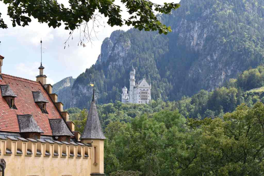 castle on a mountainside as seen from another castle