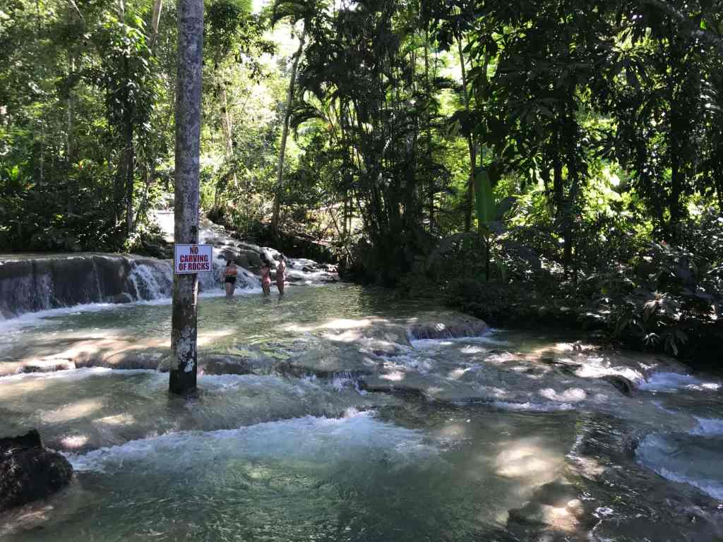 Dunns River Falls tiered smooth stone waterfall in ocho rios jamaica