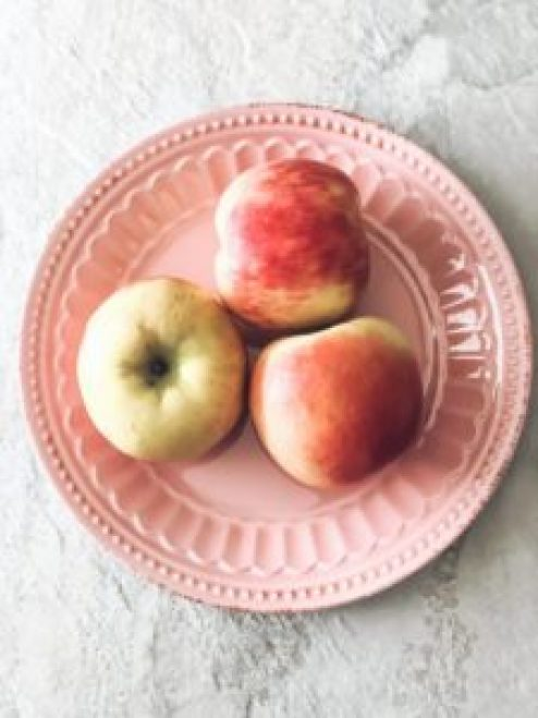 healthy valentine's treat red honeycrisp apples on a pink plate