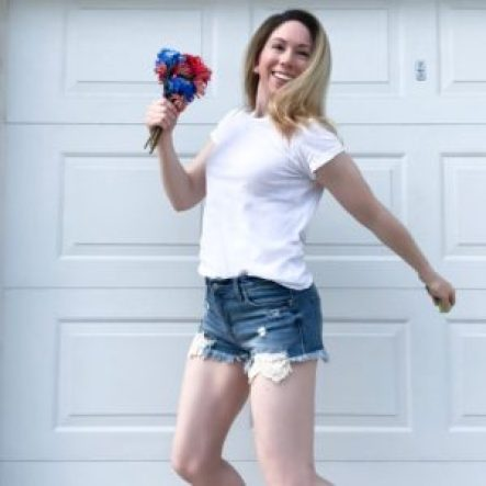 mom jumping with red and blue flowers; military mom tribute