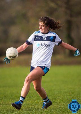 Junior ladies player kicking