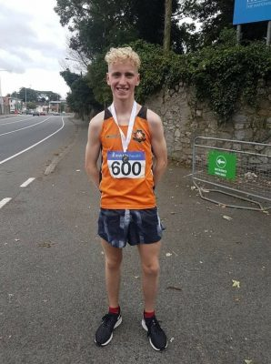 Aaron with his silver 5000m medal.jpg