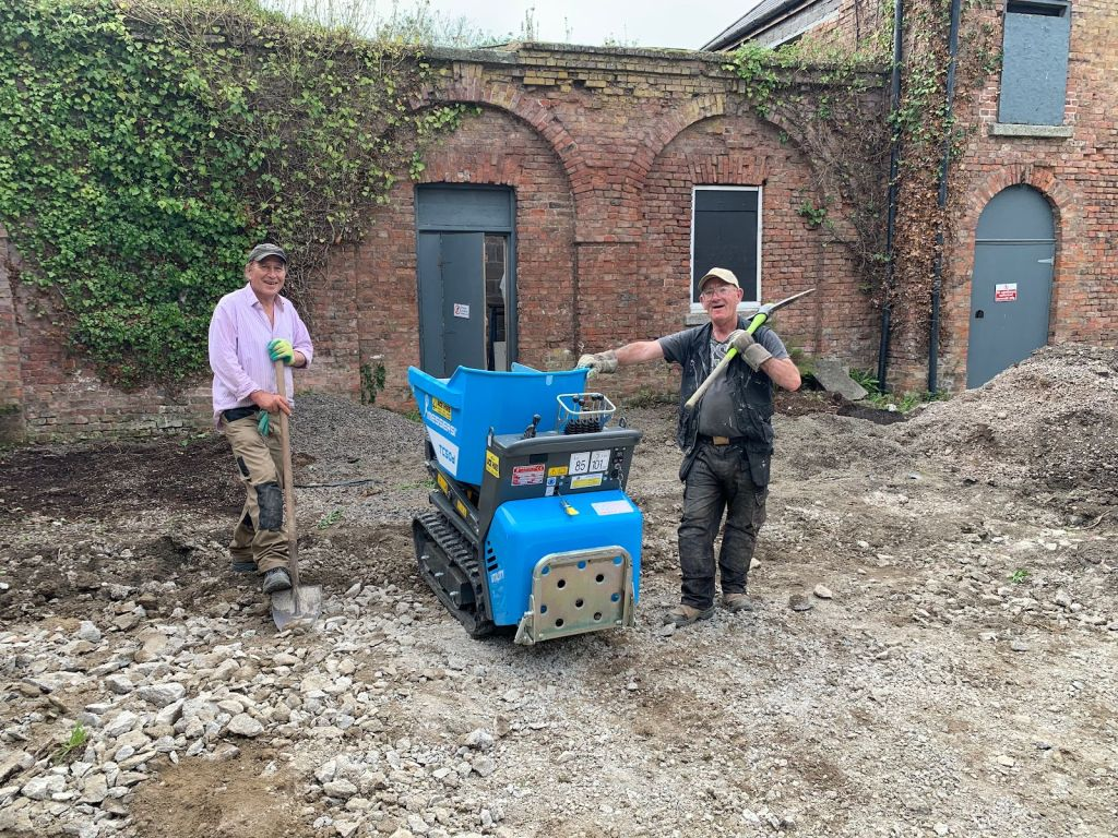 Jim & Larry helping do up the courtyard