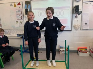 Science week fun with table balancing at Donacarney Girls' school
