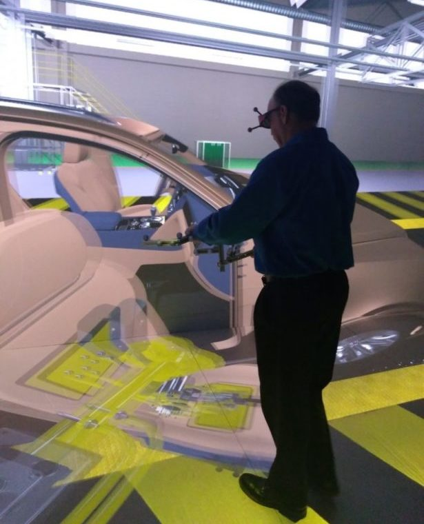 Virtual Reality CAVE using Mechdyne getReal3D to view and manipulate a virtual prototype of a large automotive model