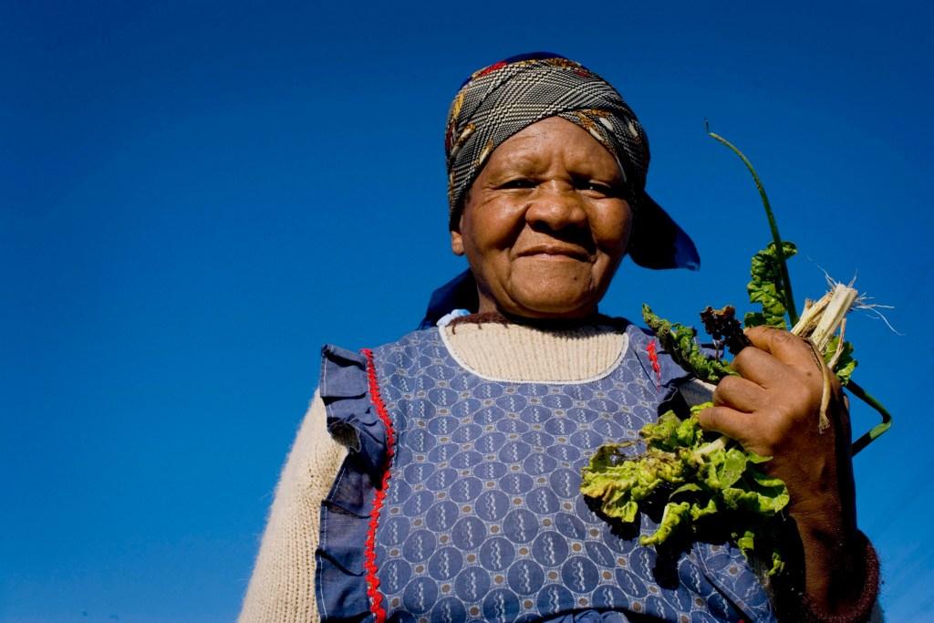 Woman grasping crops
