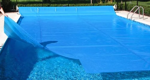 energy saving tips for swimming pools use a solar cover heat retention