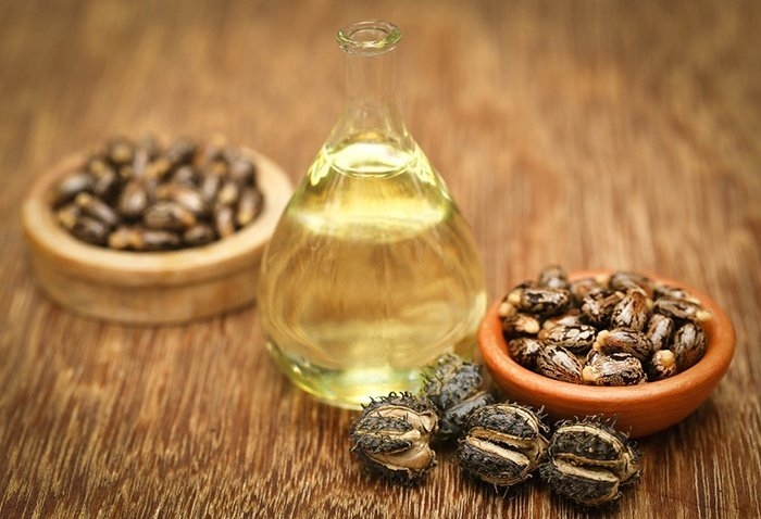 Castor beans and oil in a glass jar (Source: Bigstockphoto)