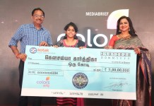 image- Anup Chandrasekharan, Business Head - COLORS Tamil and Kodeeswari Host Radikaa Sarathkumar with Kodeeswari's first winner, Kousalya Kharthika