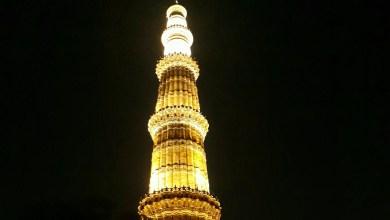 Photo of An illuminated Qutub Minar