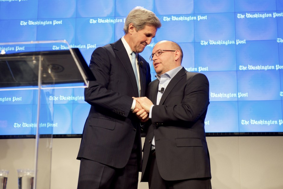 secretary_kerry_clasps_hands_with_washington_post_reporter_jason_rezaian_after_he_addressed_a_ceremony_to_dedicate_new_washington_post_headquarters_24377821180