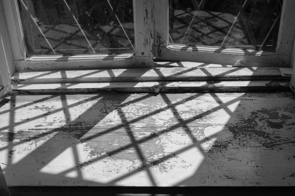 Window sill with faded paint.
