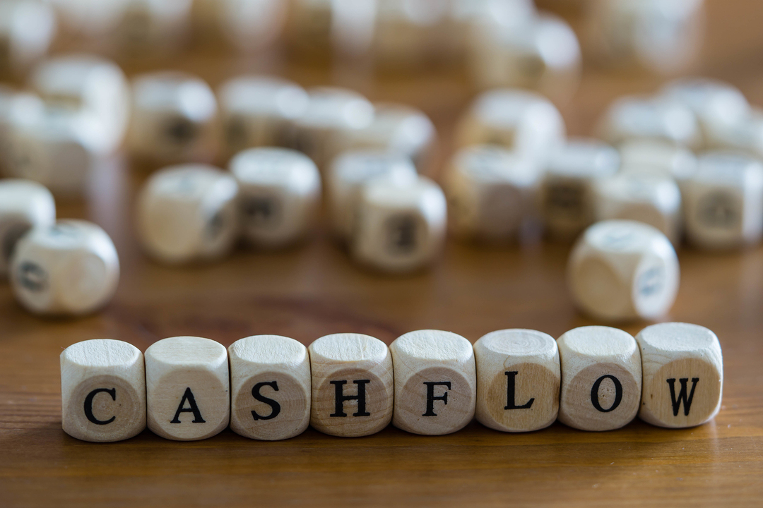 Cashflow spelled out with wooden blocks.