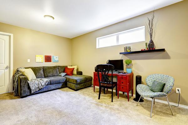 Basement living room with window.