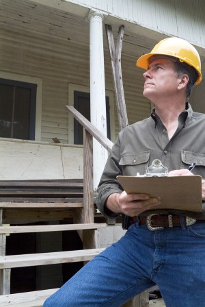 Home inspector looking at a home.