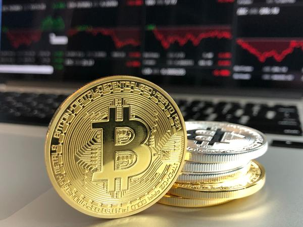 Gold and Silver bitcoin coins.