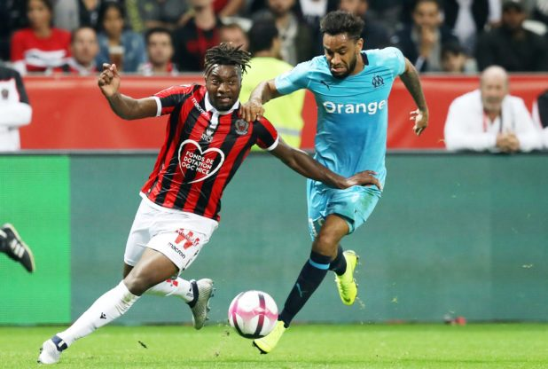 Olympique de Marseille's French defender Jordan Amavi (R) fights for the ball with Nice's French midfielder Adrien Tameze (L) during the French championship L1 football match between OGC Nice and Olympique de Marseille on October 21, 2018 at the Allianz Riviera stadium in Nice, France - Photo VALERY HACHE / AFP / DPPI