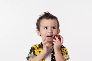 Child with Apple Image
