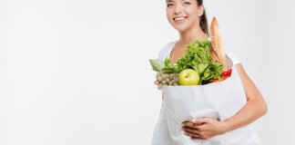 happy-woman-holds-fruit-and-vegetable