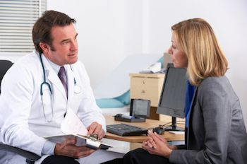 Lady talking to a doctor