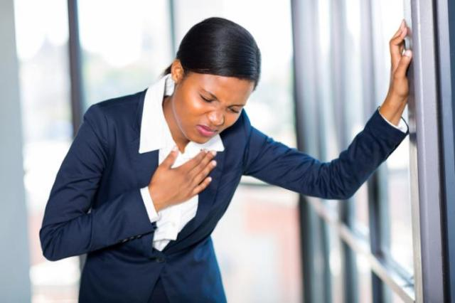 A woman experiencing chest pains.