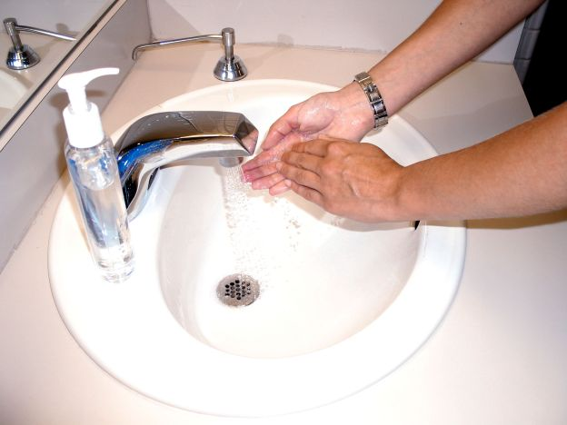Washing hands with soap and water or an alcohol scrub