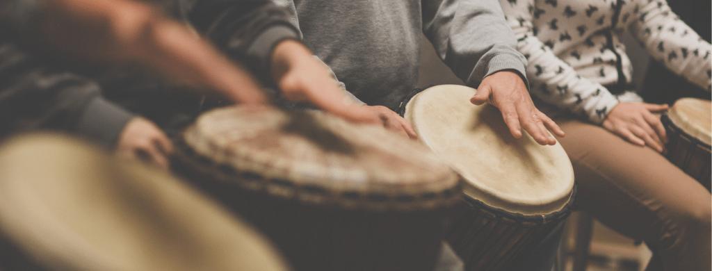 People hand drumming on djembe's