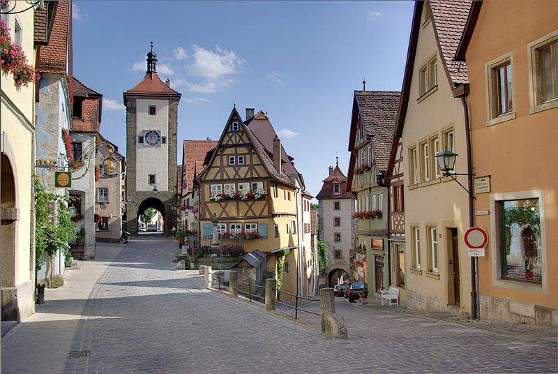 Rothenburg ob der Tauber, the place is called Plönlein a former marketplace, on the left side the Siebers-gate on the right the Kobolzeller-gate. This is one of the most photographed and painted places in Germany