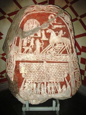 This image is usually interpreted as a Valkyrie who welcomes a dead man, or Odin himself, on the Tjängvide image stone from Gotland, in the Swedish Museum of National Antiquities in Stockholm.