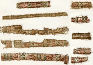 Silk textiles from the Persian region were found in the Oseberg ship. Among the motifs, we can see parts of special birds associated with Persian mythology, combined with clover-leaf axes, a Zoroastrian symbol taken from the Zodiac. The textiles have been cut into thin strips and used for adornment on clothing. Similar strips have also been found in other Viking Age burial sites. Photo: University of Oslo