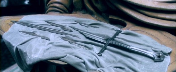 The shards of Narsil in Peter Jackson's The Lord of the Rings: The Fellowship of the Ring. Note that in the book, it is broken into only two pieces.