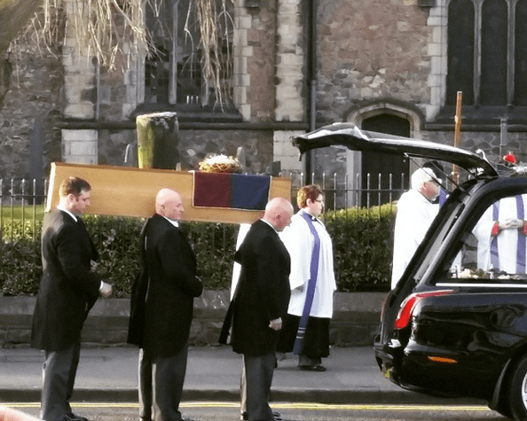 Richard being removed from the hearse