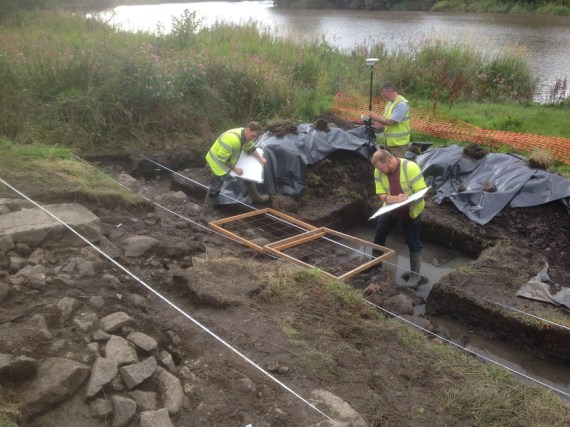 GUARD Archaeologists recording the medieval harbour © GUARD Archaeology Ltd