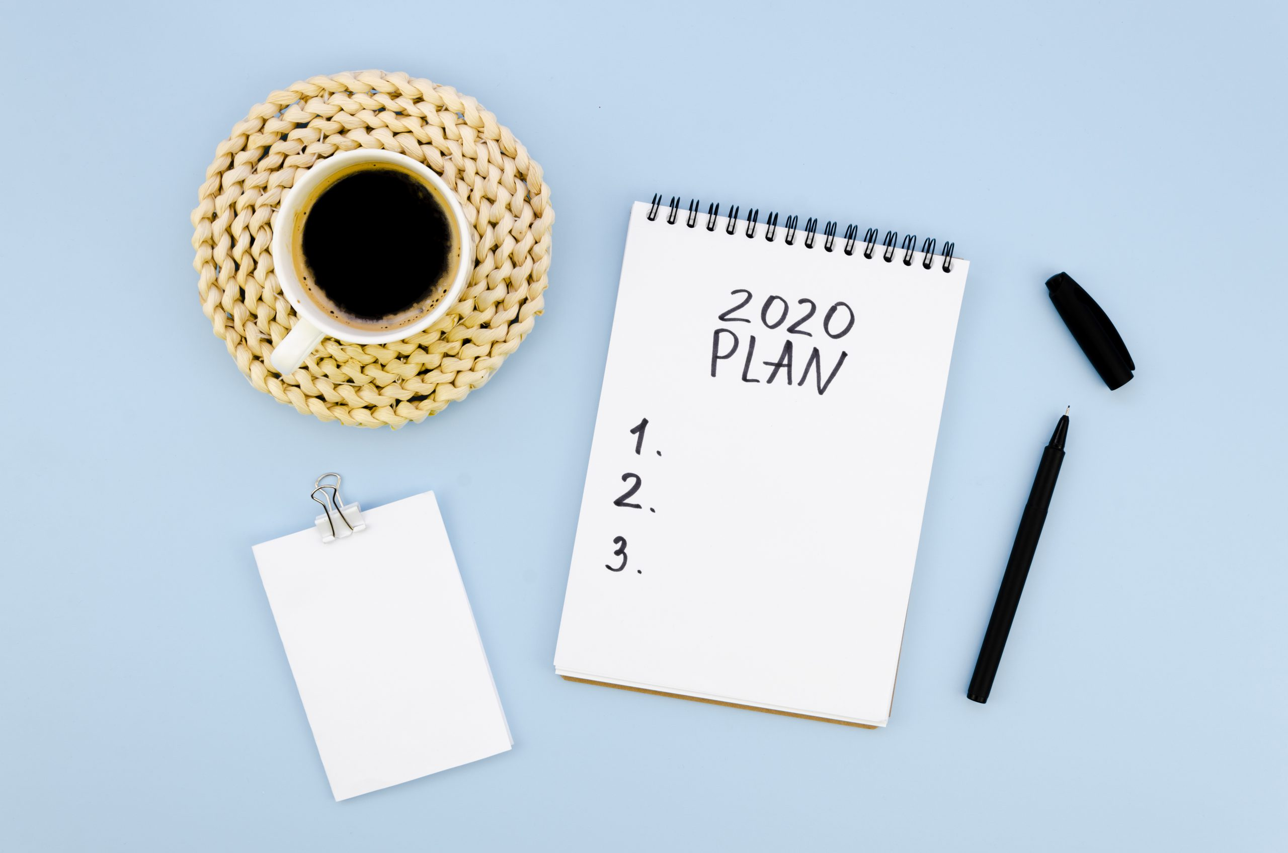 Planning for 2020 with coffee and notes pad. MEDIjobs