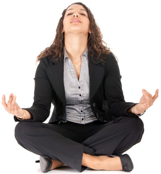 Young business woman in yoga position taking a breath